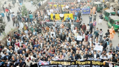 The Bangladesh Hindu, Buddhist and Christian Unity Council on Tuesday brings out a procession in front of the National Press Club in protest at attacks on religious minorities. — New Age photo